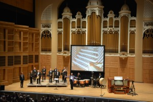 Ray Cornils ... back on stage in front of the renovated Kotzschmar Organ.